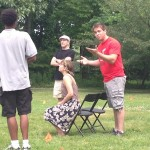 Brandon Pierce (Valentine), James Kassees (Thurio), Emilie Krause (Silvia), and M. Tyler Horn (Duke) rehearse at Rockwood Park.