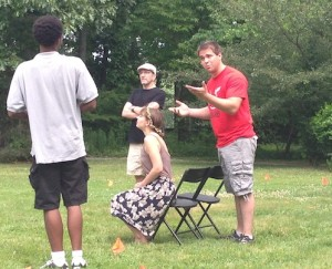 Brandon Pierce (Valentine), James Kassees (Thurio), Emilie Krause (Silvia), and M. Tyler Horn (Duke) rehearse at Rockwood Park.
