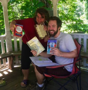 J.J. Van Name (Abbess and Text Coach) and Chase Byrd revelling in text research books