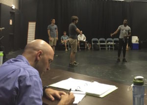 Director David Stradley taking notes during rehearsal